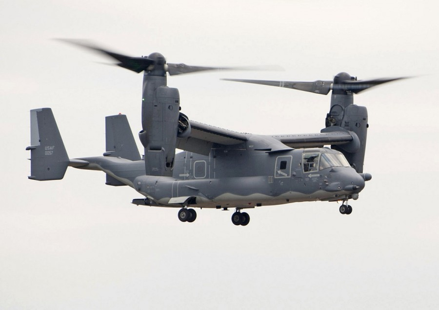 A CV-22 Osprey from the 7th Special Operations Squadron hovers during an exercise at RAF Fairford, England, Dec. 10, 2013. The 352nd Special Operations Group conducted an exercise involving approximately 150 Airmen and six aircraft at RAF Fairford from Dec. 9-12. The CV-22 Osprey is a tiltrotor aircraft that combines the vertical takeoff, hover and vertical landing capabilities of a helicopter with the long range, fuel efficiency and speed characteristics of a turboprop aircraft. (U.S. Air Force photo by Staff Sgt. Stephen Linch/Released)