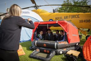 Youngsters at the RAF100 Aircraft Tour in Cardiff try out the rescue dinghy used by the RAF Wessex helicopter which was one of the aircraft on display