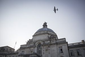 A Lancaster bomber flies past Cardiff City Hall before a gala dinner to commemorate the 100th anniversary of the RAF